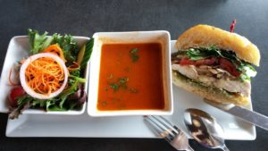 Day's special, chicken burger with brie, pear mushrooms, tomato, spinach, pesto & salad & red pepper bisque